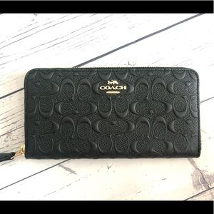 Coach black leather wallet - signature debossed